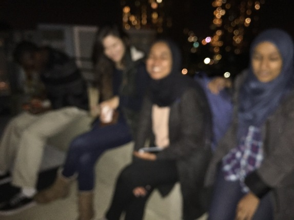 Awful out-of-focus picture of my friends having coffee on the rooftop after dinner and dessert to celebrate fall break!