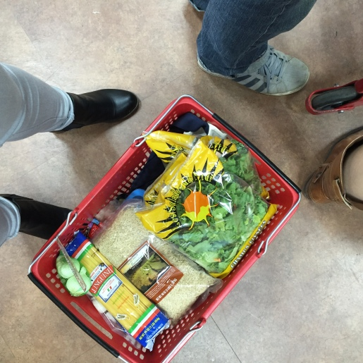 Me, pushing my basket through Trader Joes' check out line because it was too heavy to carry.